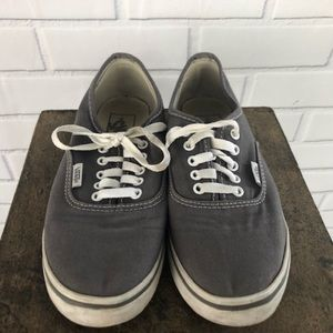 Vans gray tennis shoes off the wall